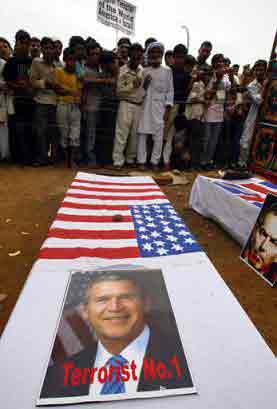 Symbolic coffins of Bush and Blair during a protest at Delhi on 20 June 04