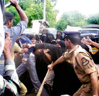 rave policemen of Andhra Pradesh attack women demonstrating against excesses on 30 August 2004