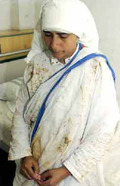 Mother Superior Kusumam of Missionaries of Charity in a Calicut hospital after being attacked on 26 September 04