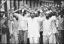 Muslim youths being rounded up at Hashimpura in 1987