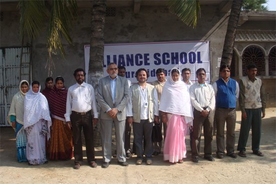 Chairman of Charity Alliance with the staff of Alliance School