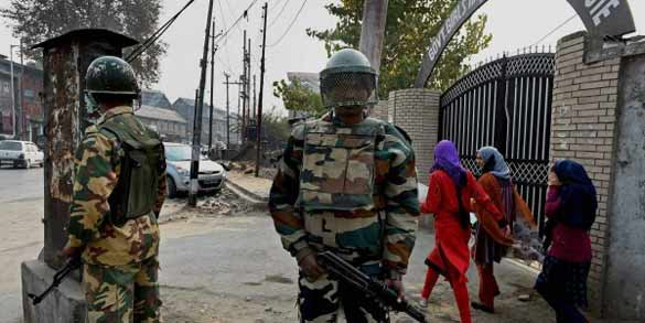 Army personnel standing guard outside a school in Kashmir. (Courtesy: P T I)