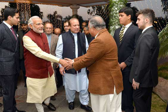 Prime Minister, Narendra Modi visits the Prime Minister of Pakistan, Nawaz Sharif's home in Raiwind, where his grand-daughter's wedding is being held, in Pakistan on December 25, 2015.