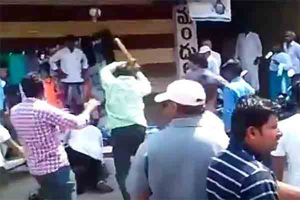 A still from the video, where a journalist was beaten up by an MLA's kin.(Twitter Photo)